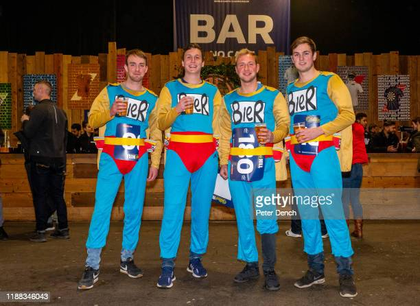 Darts fans wear fancy dress costumes in the Fans Village during the 2020 William Hill World Darts Championship at Alexandra Palace on December 13,...
