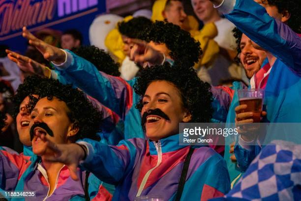 Darts fans wear fancy dress in the main competition arena during the 2020 William Hill World Darts Championship at Alexandra Palace on December 13,...