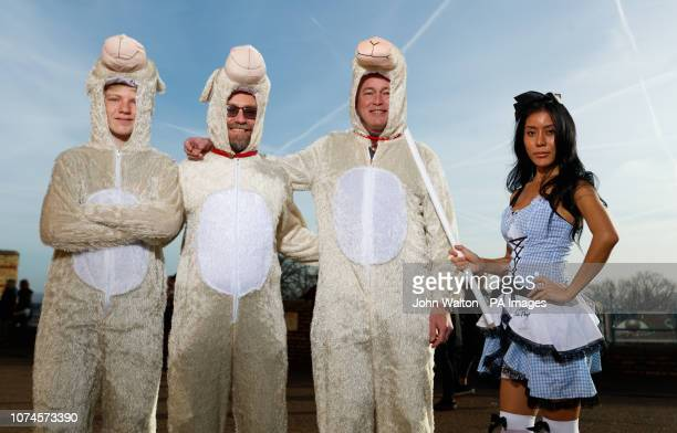 Darts fans wearing Little Bo Peep and her sheep fancy dress outfits arrive before the start of the day's play during day ten of the William Hill...