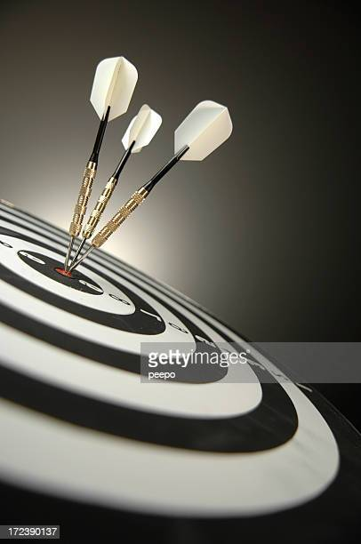 Darts in Bullseye on Dartboard