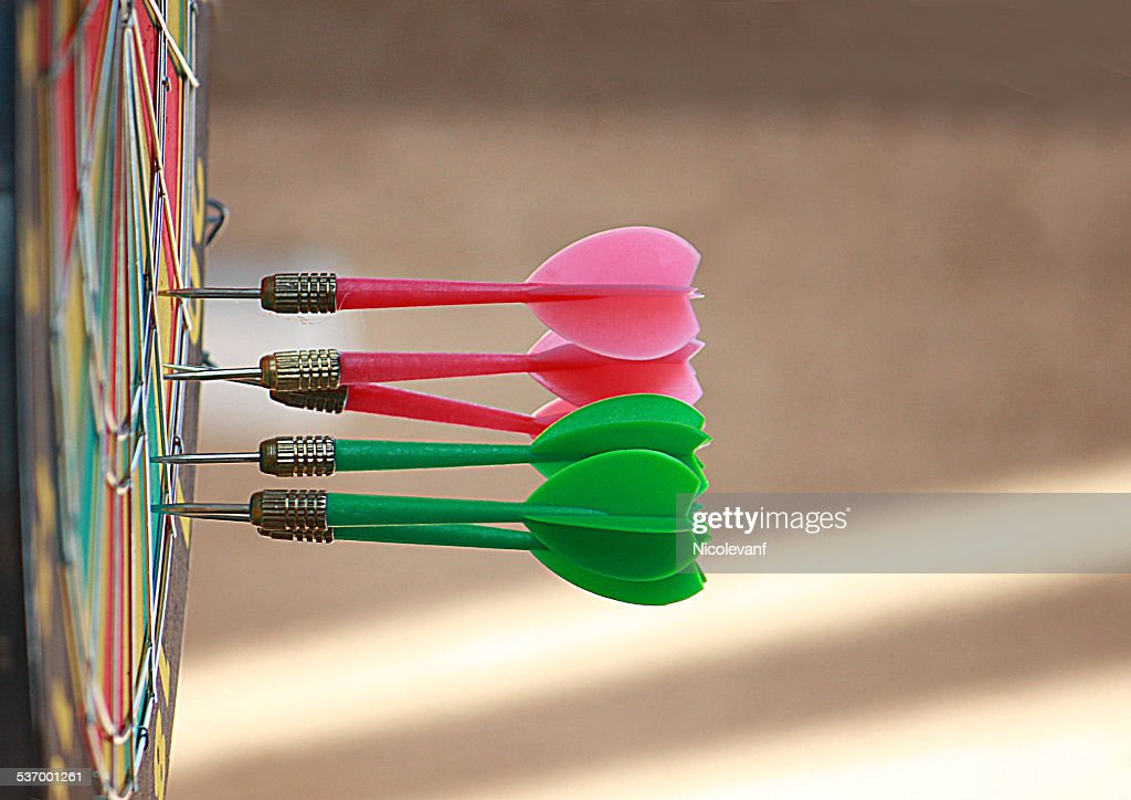 Darts in dartboard : Stock Photo
