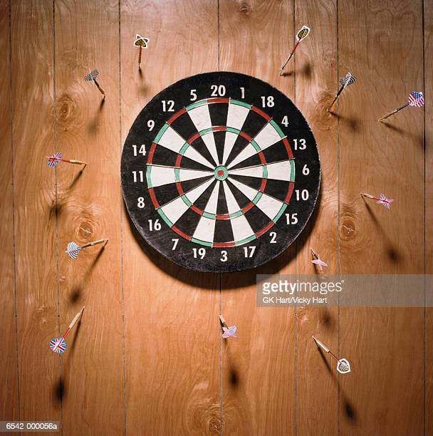 darts in wall - failure stock pictures, royalty-free photos & images
