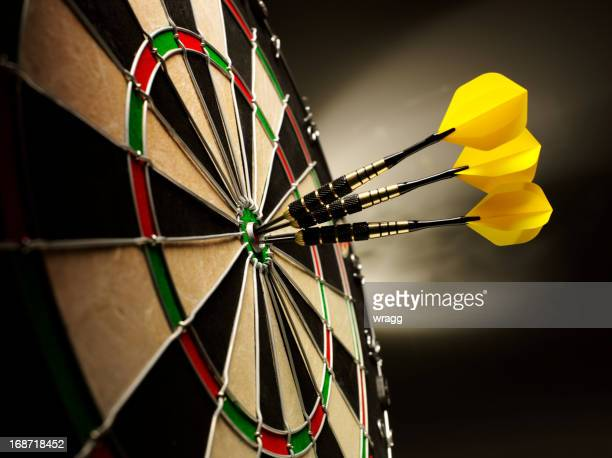 darts on target - possible stock pictures, royalty-free photos & images