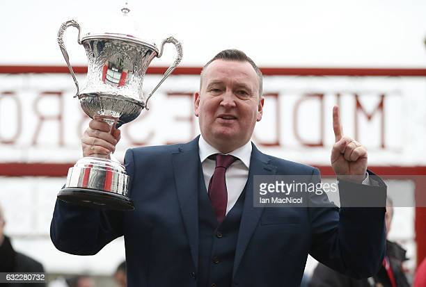 Darts player Glen Durrant poses for a photo with the BDO trophy outside the stadium prior to the Premier League match between Middlesbrough and West...