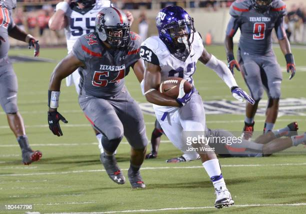 Dartwan Bush of the Texas Tech Red Raiders pursue BJ Catalon of the TCU Horned Frogs during game action on September 12 2013 at ATT Jones Stadium in...