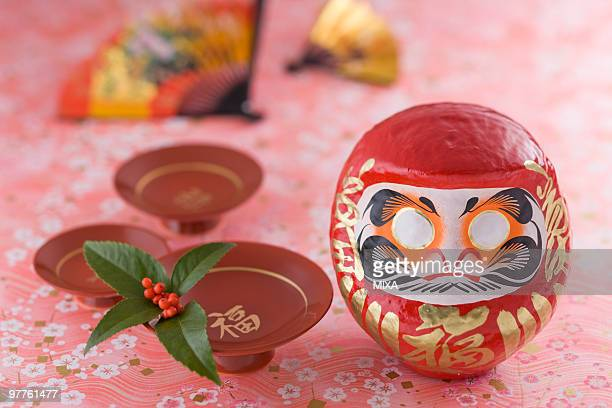 Daruma doll and sake cup