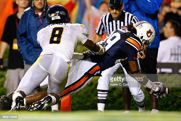 Darvin Adams of the Auburn Tigers scores a touchdown against Keith Tandy of the West Virginia Mountaineers at JordanHare Stadium on September 19 2009...