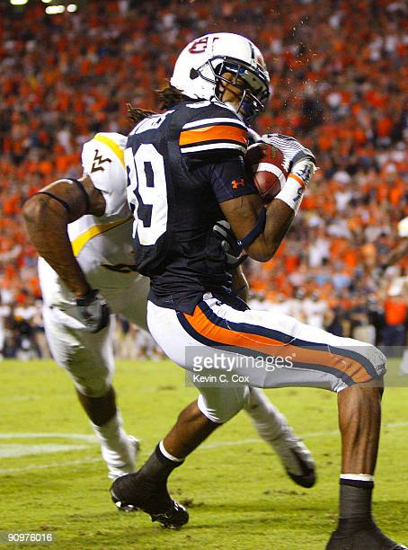 Darvin Adams of the Auburn Tigers scores a touchdown as he gets tackled by Robert Sands of the West Virginia Mountaineers at JordanHare Stadium on...