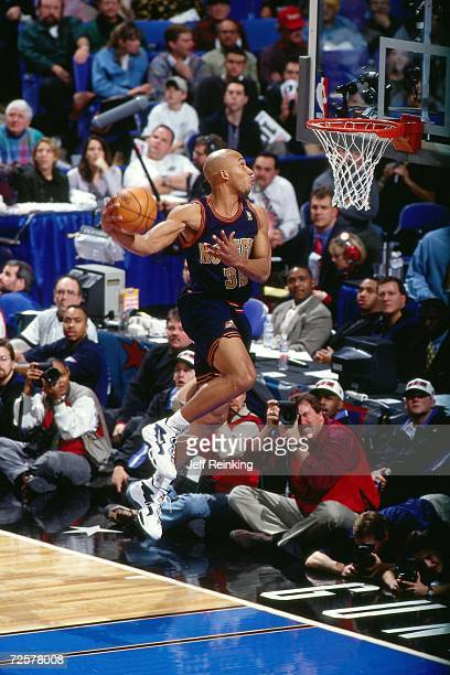 Darvin Ham of the Denver Nuggets soars for a dunk during the 1997 Nestle Crunch Slam Dunk Contest on February 8 1997 at the Gund Arena in Cleveland...