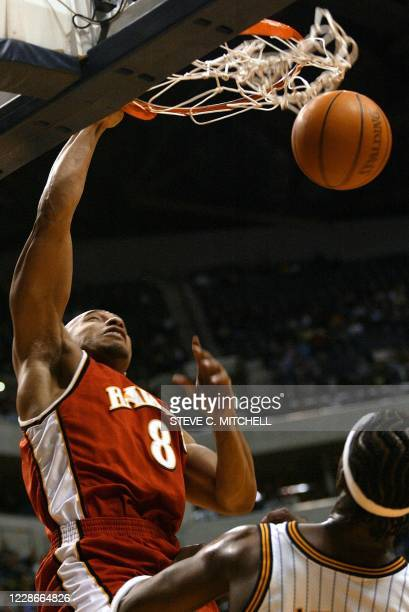 Darvin Hamm of the Atlanta Hawks slams down two points over Indiana's Jermaine O'Neal during the first half of their NBA game 14 February 2003 at...
