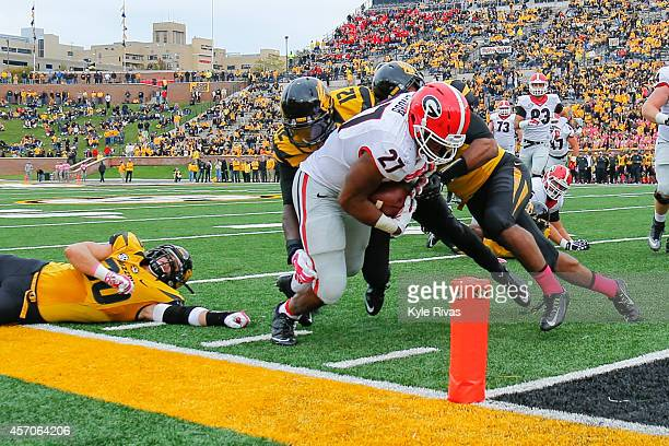 Darvin Ruise and Thomas Wilson of the Missouri Tigers fail to keep Nick Chubb of the Georgia Bulldogs out of the end zone late in the fourth quarter...