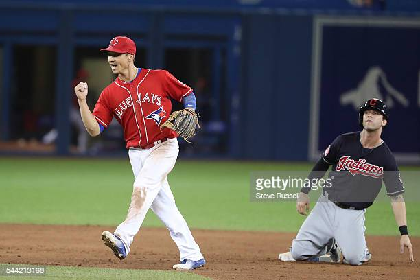 TORONTO ON JULY 1 Darwin Barney celebrates turning an inning ending double play to help Toronto Blue Jays second baseman Ryan Goins get out without...