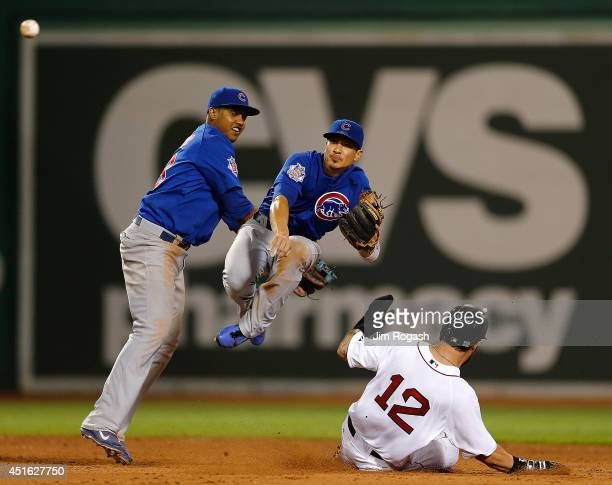 Darwin Barney of the Chicago Cubs collides with Starlin Castro trying to turn a double play as Mike Napoli of the Boston Red Sox slides in the eighth...
