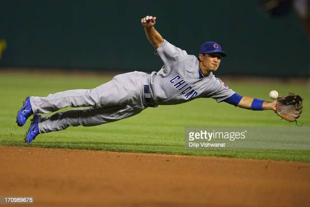 Darwin Barney of the Chicago Cubs dives for a line drive against the St. Louis Cardinals eighth inning at Busch Stadium on June 20, 2013 in St....