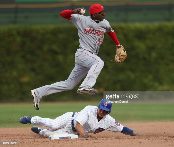 Darwin Barney of the Chicago Cubs forces Didi Gregorius of the Cincinnati Reds into missing a double play throw at Wrigley Field on September 20,...