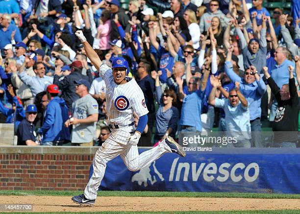 Darwin Barney of the Chicago Cubs hits a walk off two run homer in the ninth inning against the San Diego Padres on May 30 2012 at Wrigley Field in...