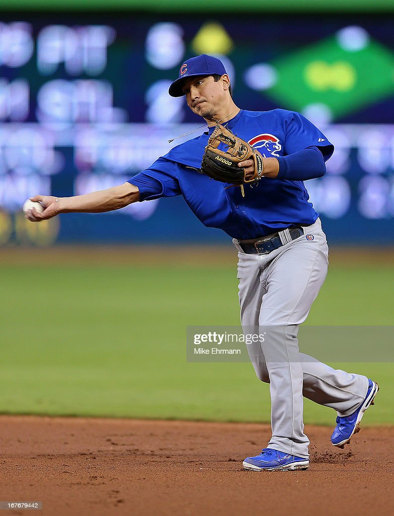 Darwin Barney #15 of the Chicago Cubs makes a throw to first during a game against the Miami Marlins at Marlins Park on April 27, 2013 in Miami, Florida.