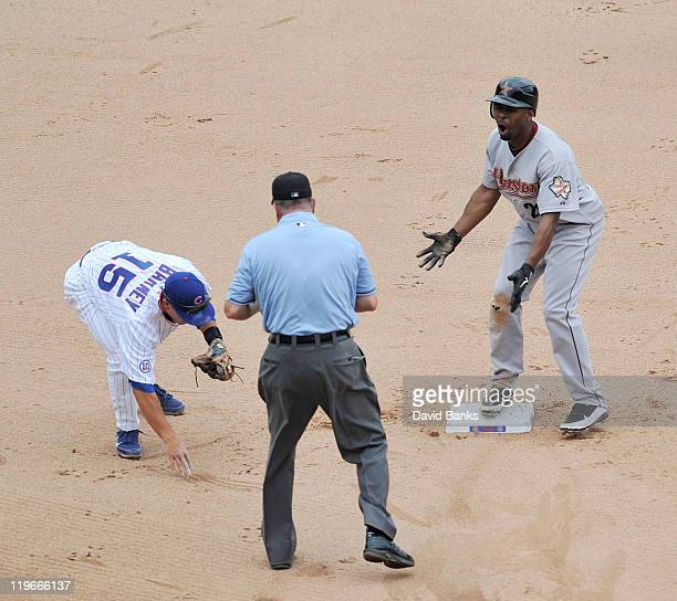 Darwin Barney of the Chicago Cubs tags Michael Bourn of the Houston Astros out at second base on July 23 2011 at Wrigley Field in Chicago Illinois...