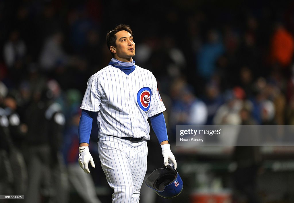 Darwin Barney of the Chicago Cubs walks off the field after making the final out against the Texas Rangers at Wrigley Field on April 16, 2013 in Chicago, Illinois. All uniformed team members are wearing jersey number 42 in honor of Jackie Robinson Day. The Rangers defeated the Cubs 4-2.