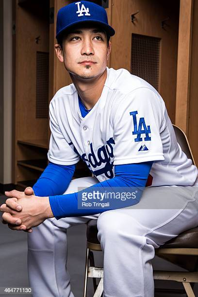 Darwin Barney of the Los Angeles Dodgers poses for a portrait during spring training photo day at Camelback Ranch on February 28 2015 in Glendale...