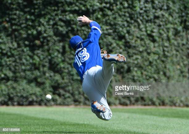 Darwin Barney of the Toronto Blue Jays dives for a single hit by Albert Almora Jr #5 of the Chicago Cubs during the second inning on August 18 2017...