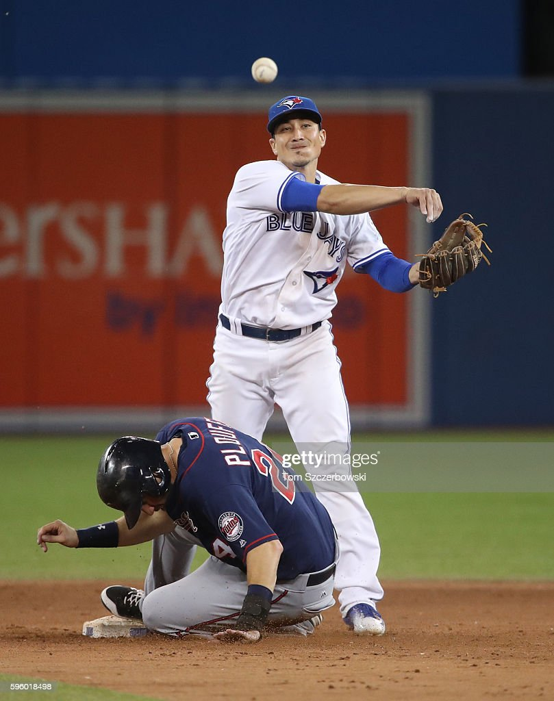 Darwin Barney #18 of the Toronto Blue Jays gets the force out at second base but cannot turn the double play in the ninth inning during MLB game action as Trevor Plouffe #24 of the Minnesota Twins slides into second base on August 26, 2016 at Rogers Centre in Toronto, Ontario, Canada.