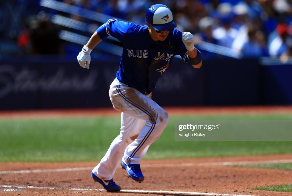 Darwin Barney #18 of the Toronto Blue Jays hits a double in the fourth inning during MLB game action against the Detroit Tigers at Rogers Centre on September 10, 2017 in Toronto, Canada.