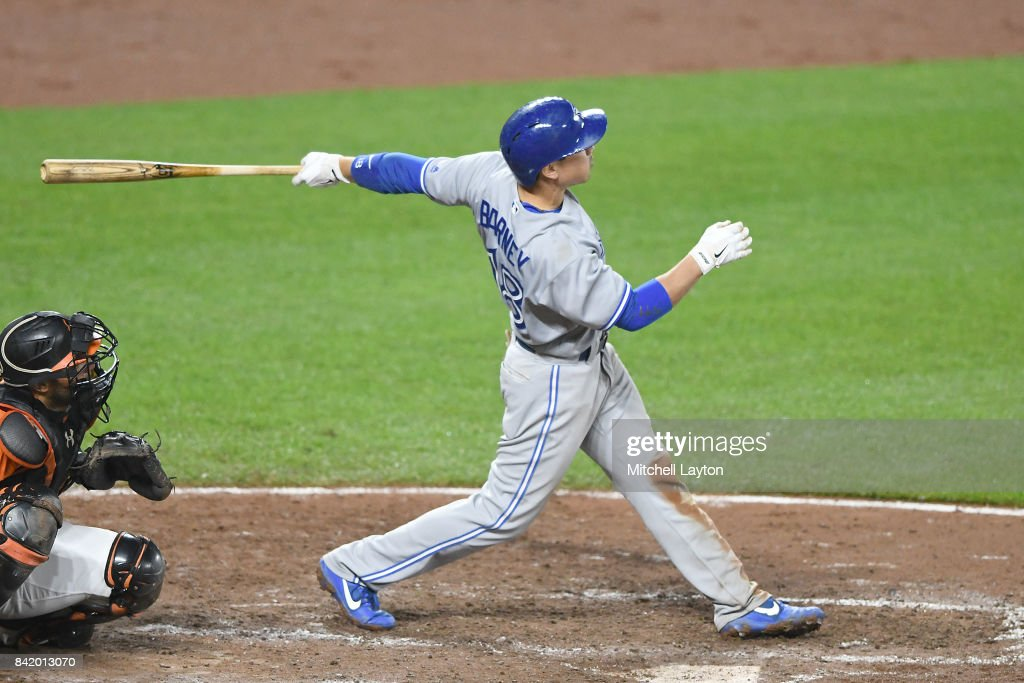 Darwin Barney #18 of the Toronto Blue Jays hits a two run home in the eighth inning during a baseball game against the Baltimore Orioles at Oriole Park at Camden Yards on September 2, 2017 in Baltimore, Maryland.