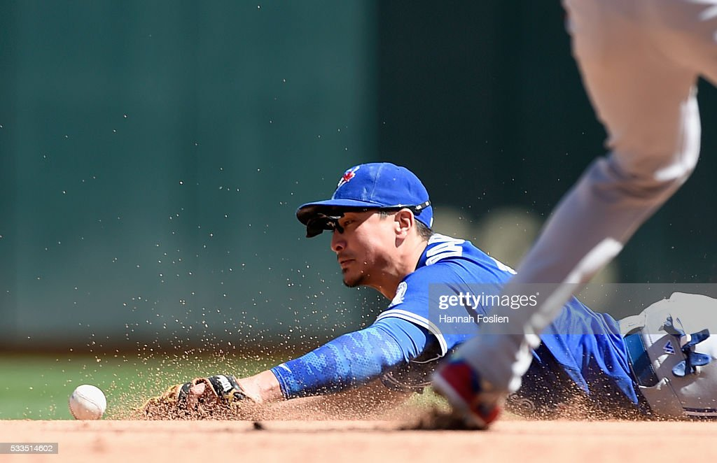 Darwin Barney #18 of the Toronto Blue Jays knocks down an infield single hit by Danny Santana #39 of the Minnesota Twins during the eighth inning of the game on May 22, 2016 at Target Field in Minneapolis, Minnesota. The Blue Jays defeated the Twins 3-1.