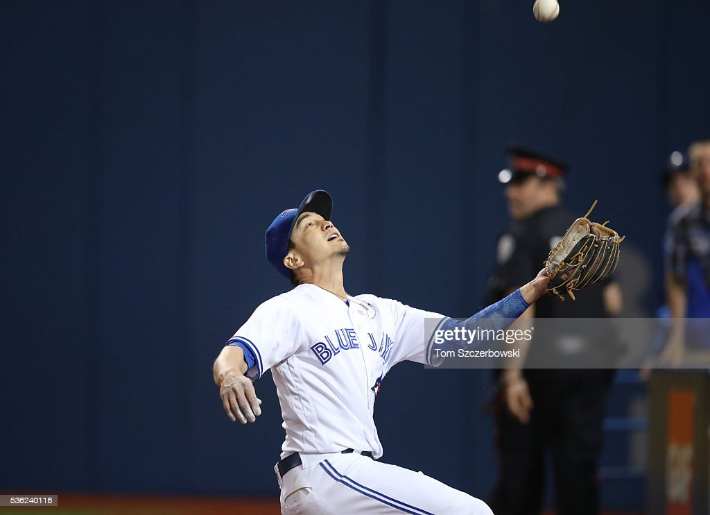 Darwin Barney #18 of the Toronto Blue Jays makes a sliding catch in foul territory in the eighth inning during MLB game action against the New York Yankees on May 31, 2016 at Rogers Centre in Toronto, Ontario, Canada.