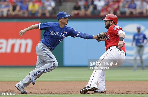 Darwin Barney of the Toronto Blue Jays makes the out against Mitch Moreland of the Texas Rangers in the second inning at Globe Life Park in Arlington...