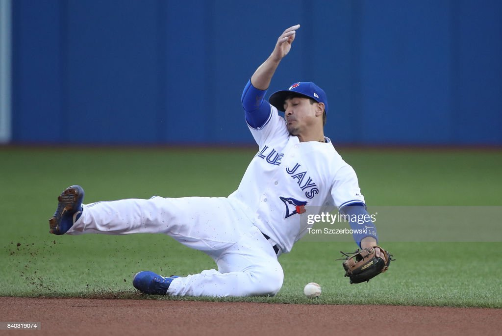 Darwin Barney #18 of the Toronto Blue Jays stops a sharp liner hit by Andrew Benintendi #16 of the Boston Red Sox for an infield single in the first inning during MLB game action at Rogers Centre on August 28, 2017 in Toronto, Canada.