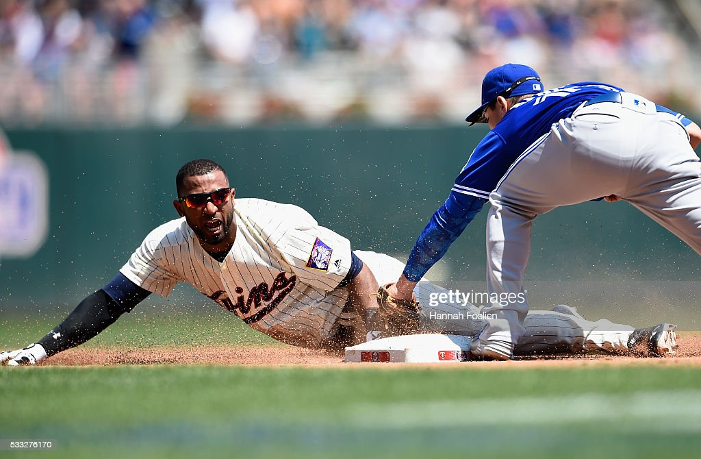 Darwin Barney #18 of the Toronto Blue Jays tags out Eduardo Nunez #9 of the Minnesota Twins at third base attempting to advance on a fly ball during the fourth inning of the game on May 21, 2016 at Target Field in Minneapolis, Minnesota. The Twins defeated the Blue Jays 5-3.
