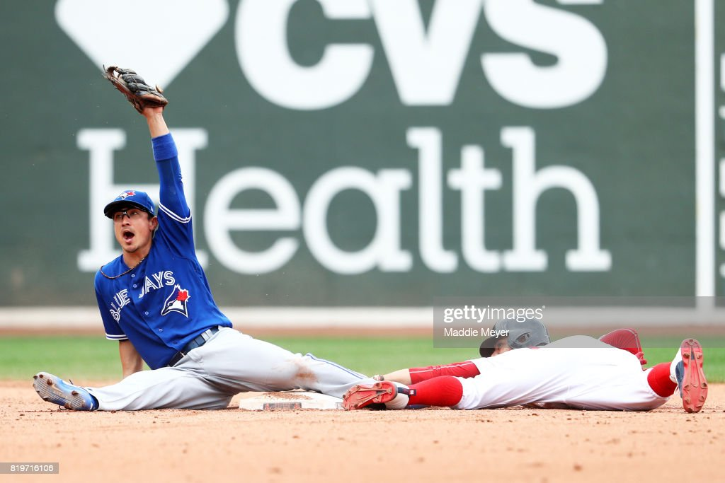 Darwin Barney #18 of the Toronto Blue Jays tags out Mookie Betts #50 of the Boston Red Sox as he tries to steal second during the fifth inning at Fenway Park on July 20, 2017 in Boston, Massachusetts.