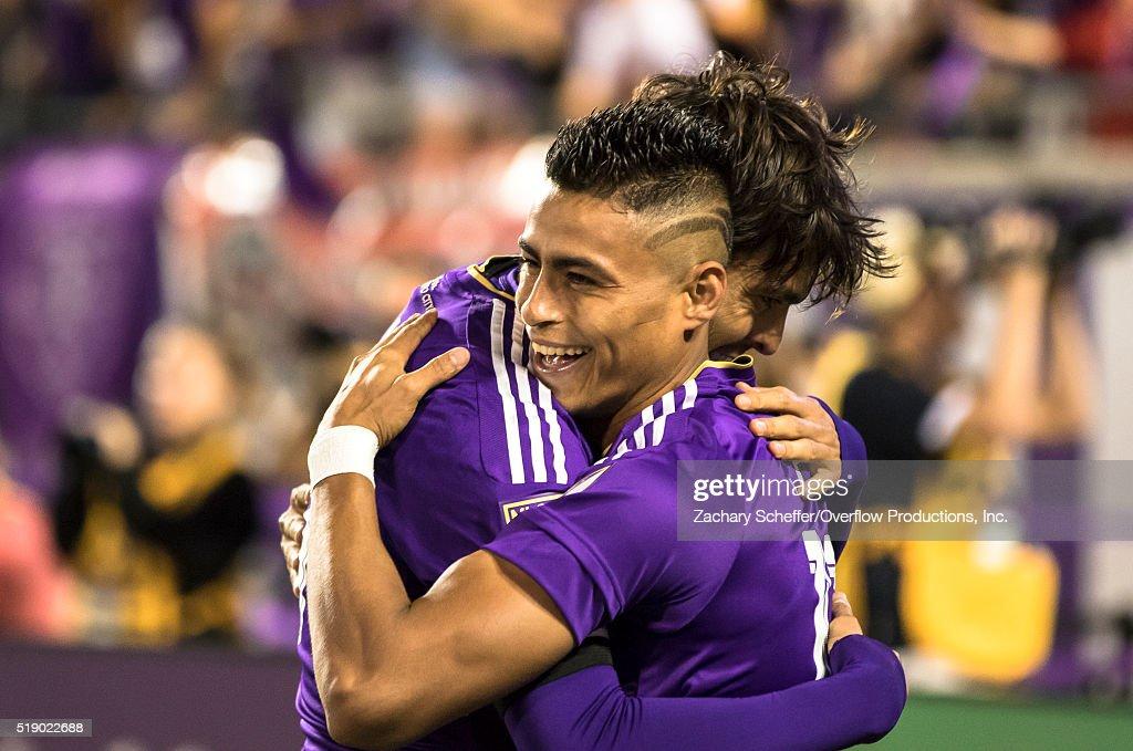 Darwin Ceren embraces teammate Ricardo Kaka of the Orlando City SC after Kaka scoredtheir third goal against the Portland Timbers at Citrus Bowl on April 3, 2016 in Orlando, Florida.