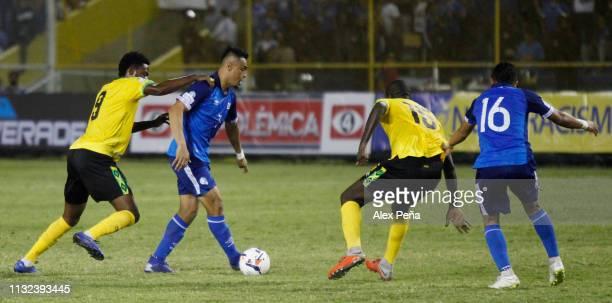 Darwin Ceren of El Salvador battles for the ball with Ricardo Morris of Jamaica during a match between El Salvador and Jamiaca as part of the...