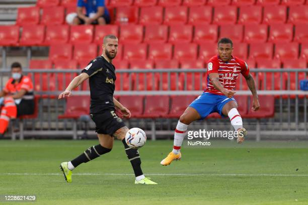 Darwin Machis and Laguardia, during the La Liga match between Granada CF and Deportivo Alaves at Nuevo Los Carmenes Stadium on September 20, 2020 in...