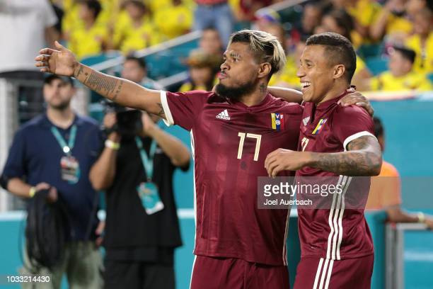 Darwin Machis celebrates his first half goal with Josef Martinez of Venezuela against Colombia during an International friendly match on September 7...