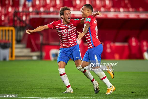 Darwin Machis of Granada celebrates with Luis Milla after scoring his team's first goal during the UEFA Europa League third qualifying round match...