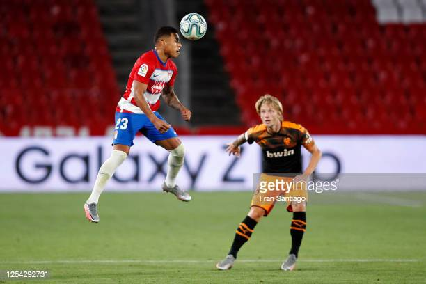Darwin Machis of Granada CF battles for the ball with Carlos Soler of Valencia CF during the Liga match between Granada CF and Valencia CF at...