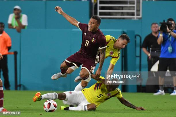 Darwin Machis of the Venezuelan National Team battles for the ball against Wilmar Barrios of the Colombian National Team during the friendly match at...
