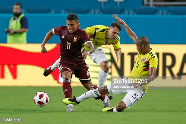 Darwin Machis of Venezuela brings the ball past Wilmar Barrios of Colombia during an International friendly match on September 7, 2018 at Hard Rock...