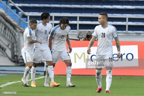 Darwin Nuñez of Uruguay celebrates with teammates after scoring the third goal of his team during a match between Colombia and Uruguay as part of...