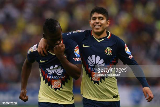 Darwin Quintero and Carlos Vargas of America celebrate their team first goal during the match between America and Saprissa as part of the round of...
