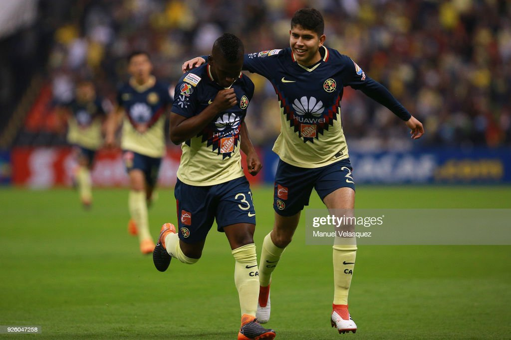 Darwin Quintero (L) and Carlos Vargas (R) of America celebrate their team first goal during the match between America and Saprissa as part of the round of 16th of the CONCACAF Champions League at Azteca Stadium on February 28, 2018 in Mexico City, Mexico.