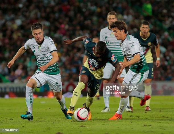Darwin Quintero of America and Ulises Rivas of Santos fight for the ball during the 17th round match between Santos Laguna and America as part of the...