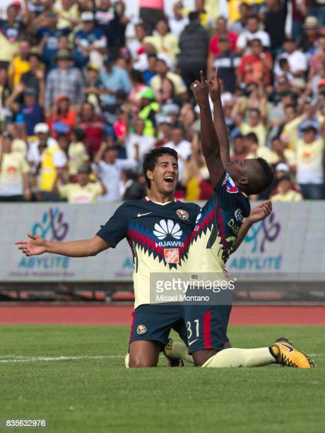 Darwin Quintero of America, celebrates with teammate Cecilio Dominguez after scoring the second goal of his team during the fifth round match between...