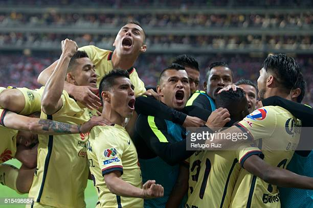 Darwin Quintero of America celebrates with teammates after scoring the first goal of the game during the 10th round match between Chivas and America...