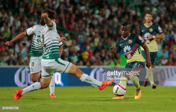 Darwin Quintero of America fights for the ball with Jose Abella of Santos during the 17th round match between Santos Laguna and America as part of...