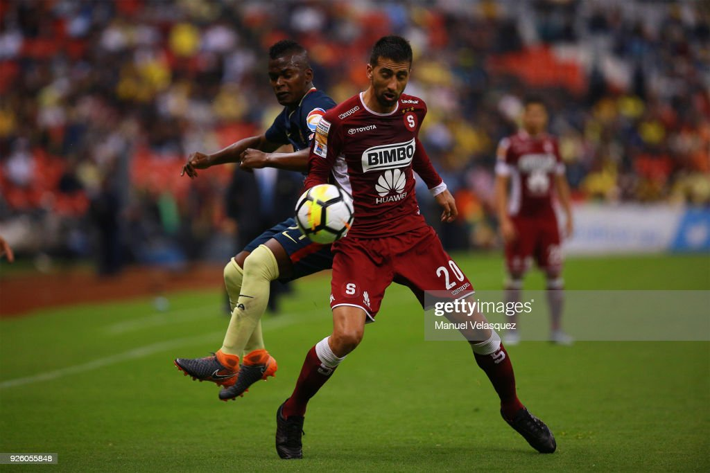 Darwin Quintero (L) of America struggles for the ball against Mariano Torres (R) of Saprissa during the match between America and Saprissa as part of the round of 16th of the CONCACAF Champions League at Azteca Stadium on February 28, 2018 in Mexico City, Mexico.